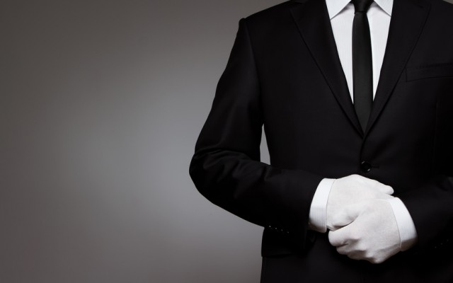At Your service. Well dressed man waiting for orders with copy s